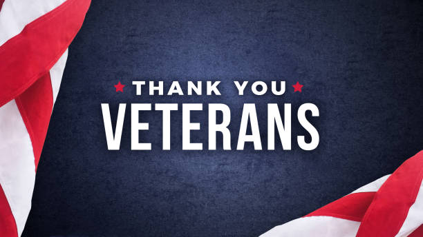 thank you veterans text with american flags over dark blue background - veterans day стоковые фото и изображения