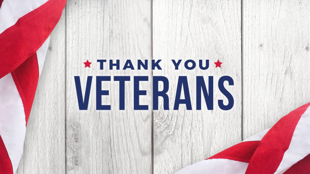 thank you veterans text with american flags over wood background - veterans day стоковые фото и изображения