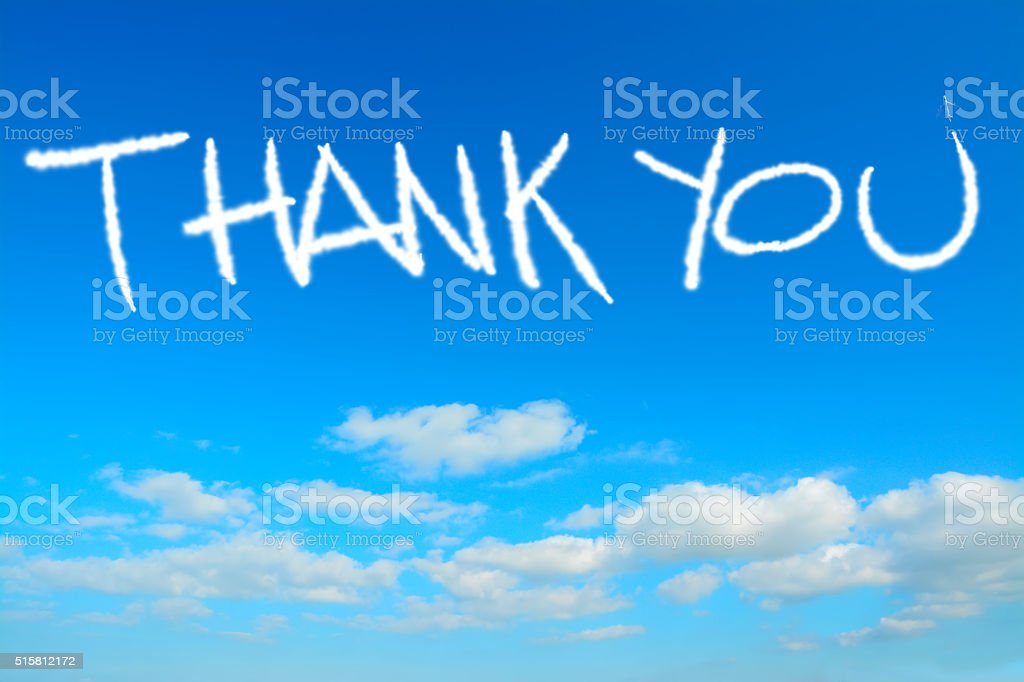thank you written in the sky stock photo