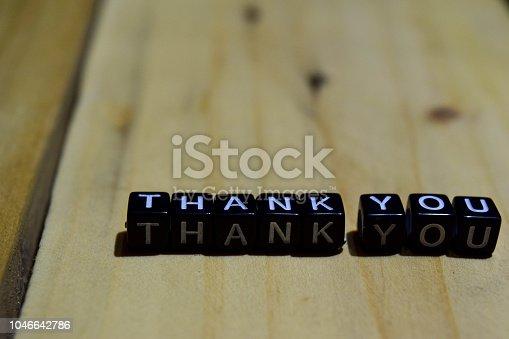 1068057246 istock photo Thank you written on wooden blocks 1046642786