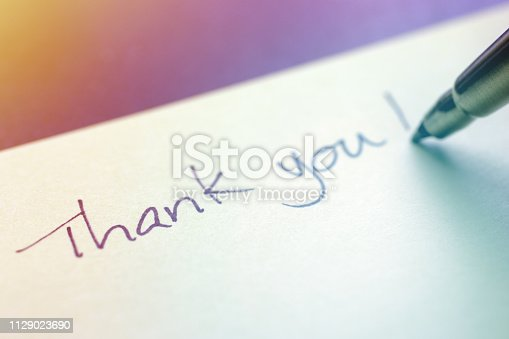 Close-up of a pen wrote a Thank You message on sticky note.
