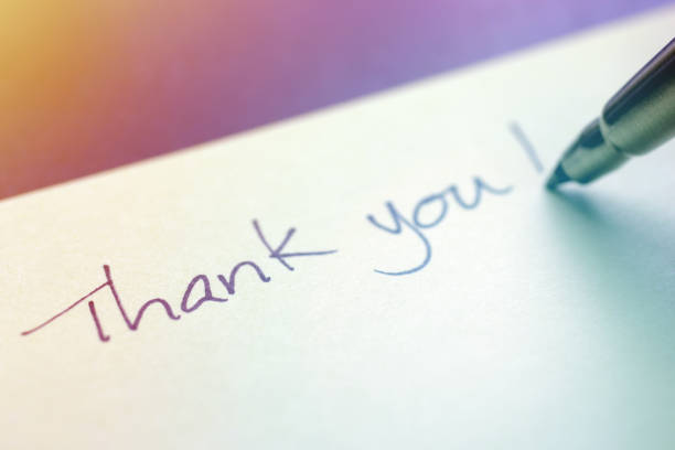 Thank You Written with a Pen on Sticky Note Close-up of a pen wrote a Thank You message on sticky note. note pad stock pictures, royalty-free photos & images