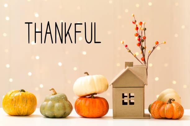 thankful message with pumpkins with a house - gratidão imagens e fotografias de stock