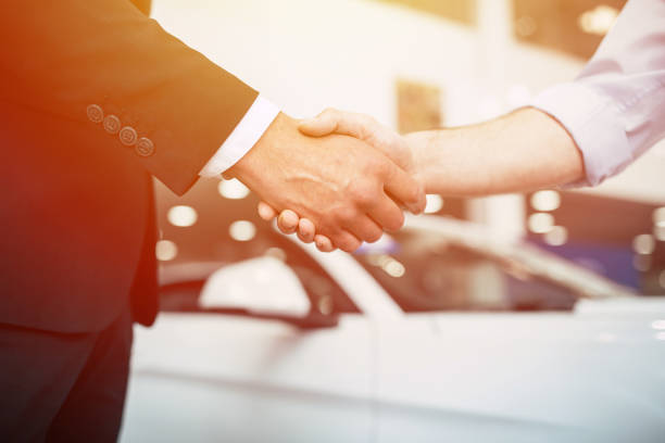 Thanks for good job Thanks for good job. Cropped photo of Handshake of two young men. car salesperson stock pictures, royalty-free photos & images