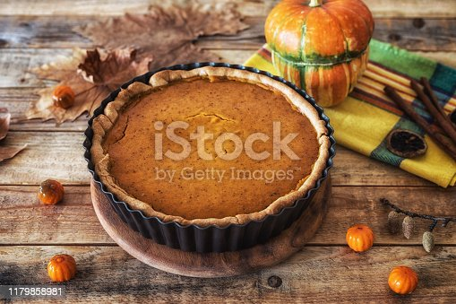 Thanksgiving dining at table, sweet pumpkin pie in mold at table, close up