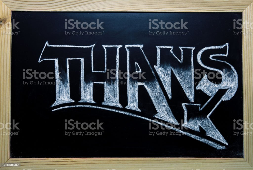 Thanks inscription by white chalk on black chalkboard. Thanks word in timber frame. stock photo