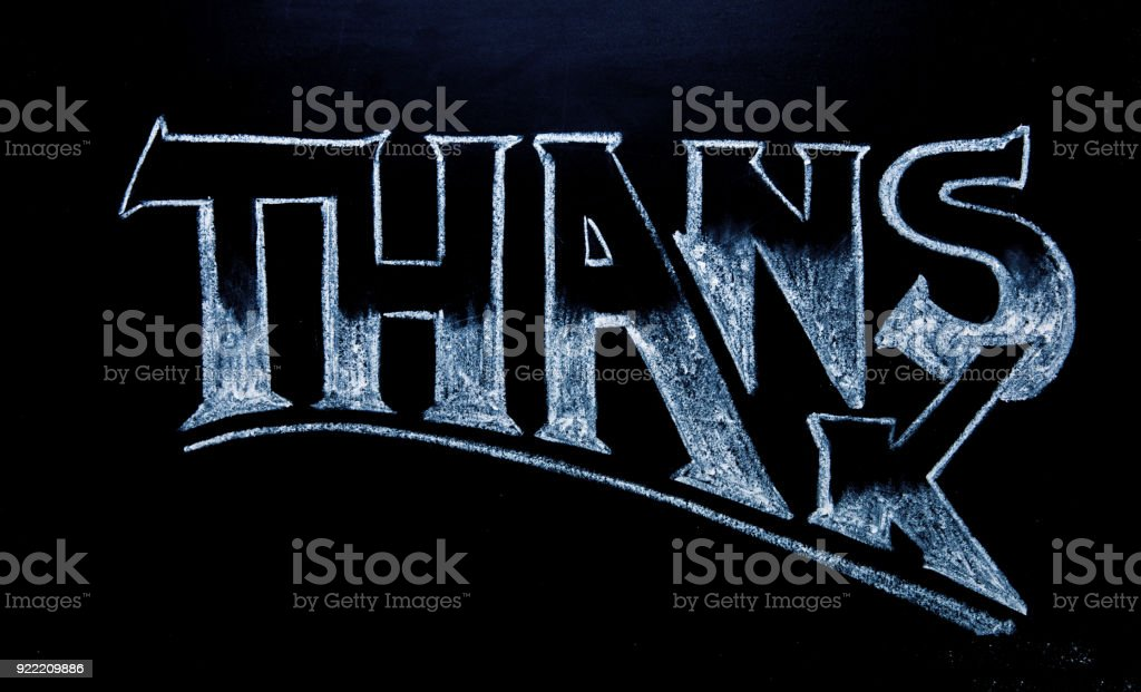 Thanks inscription by white chalk on black chalkboard. Thanks word on blackboard. Shop label. stock photo