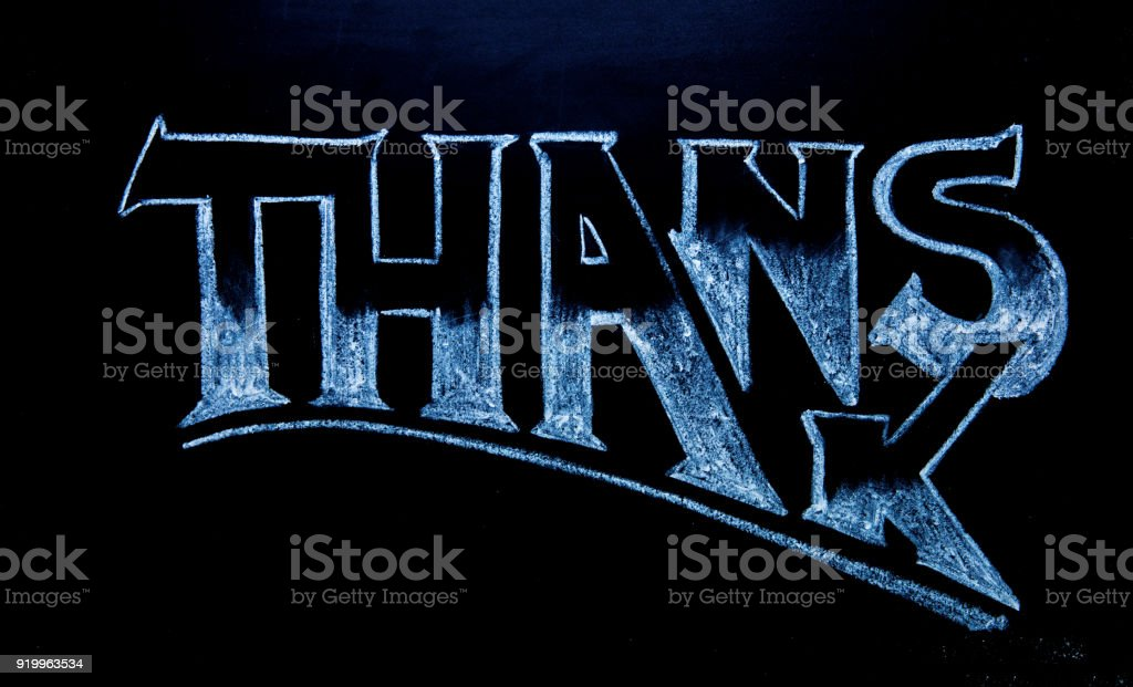 Thanks lettering by white chalk on black chalkboard. Thanks word on blackboard. stock photo