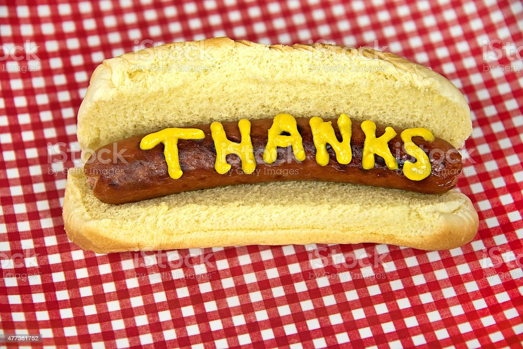 thanks on hot dog with mustard Thanks written in mustard on a hot dog with bun. 2015 Stock Photo