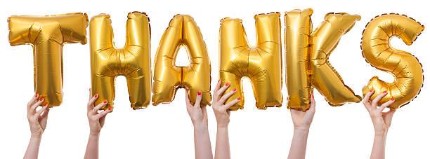 Grazie parola in oro palloncini - foto stock