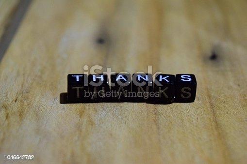 1068057218 istock photo Thanks written on wooden blocks 1046642782