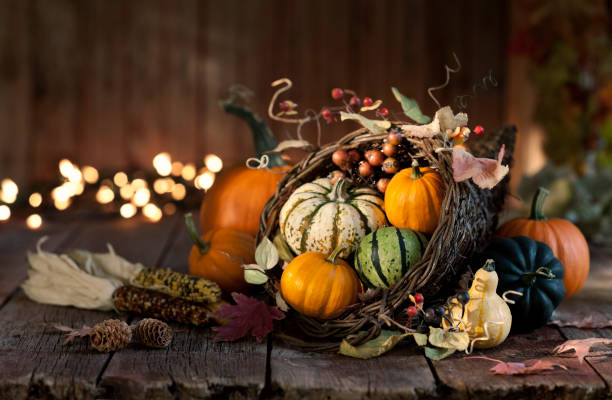 thanksgiving autumn harvest pumpkin cornucopia - thanksgiving stock pictures, royalty-free photos & images