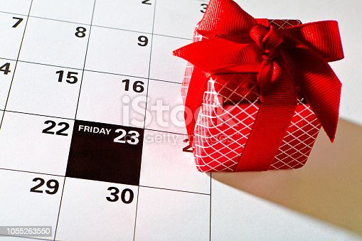 A calendar page with red gift box for the 2018, 2029 Black Friday retail shopping day, marking November 23 Friday, the day after Thanksgiving for the beginning of the Christmas shopping period.