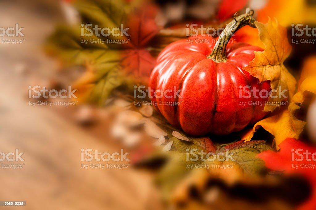 Thanksgiving centerpiece with autumn pumpkin, floral decorations. stock photo