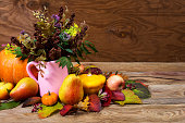 Thanksgiving centerpiece with wild flowers and grass in pink pitcher vase