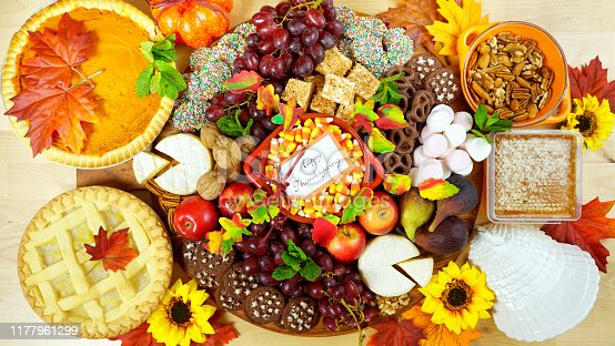 Happy Thanksgiving cheese and dessert grazing platter charcuterie board with pumpkin and apple pie.Happy Thanksgiving cheese and dessert grazing platter charcuterie board with pumpkin and apple pie, with copy space.