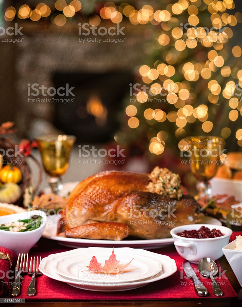 Thanksgiving or Christmas elegant holiday turkey dinner in front of...