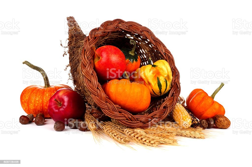 Thanksgiving cornucopia with pumpkins, apples and gourds isolated on white stock photo