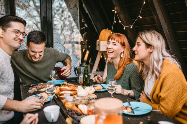 thanksgiving day celebration with friends stock photo