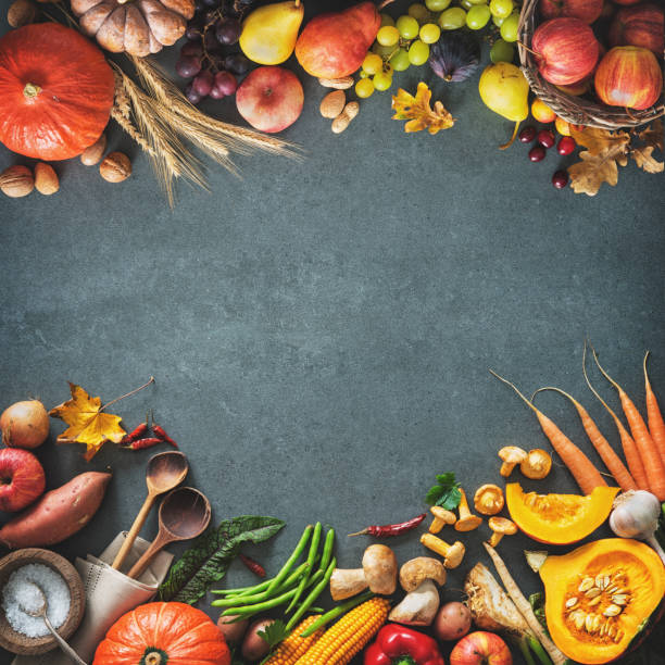 Thanksgiving day or seasonal autumnal background with pumpkins, vegetables and fruits stock photo