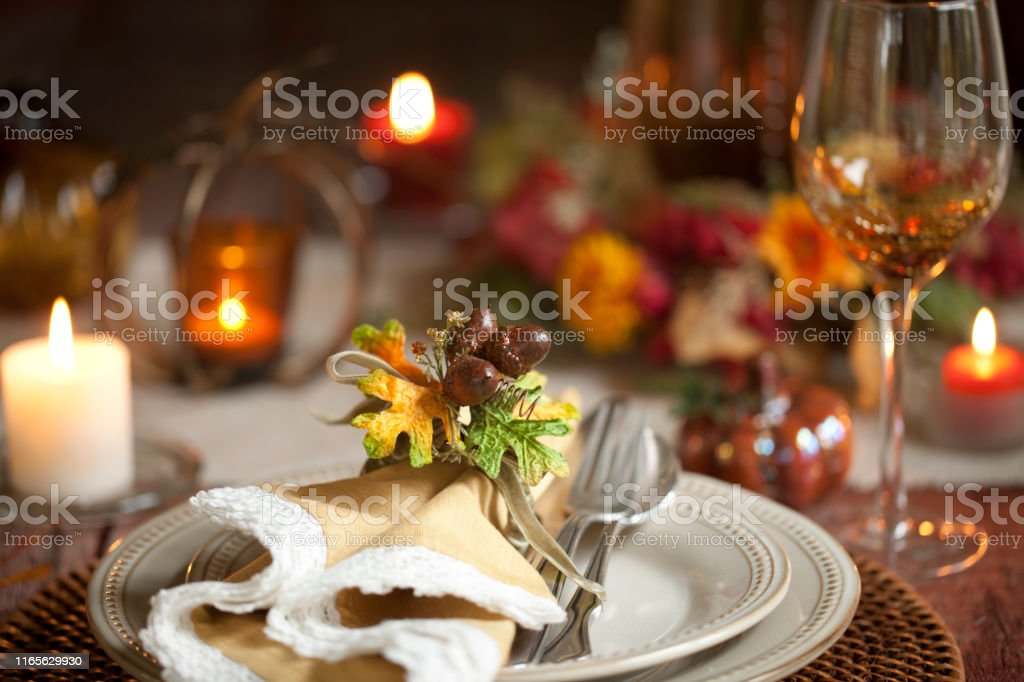 Elegant autumn Thanksgiving dining place setting on an old rustic...