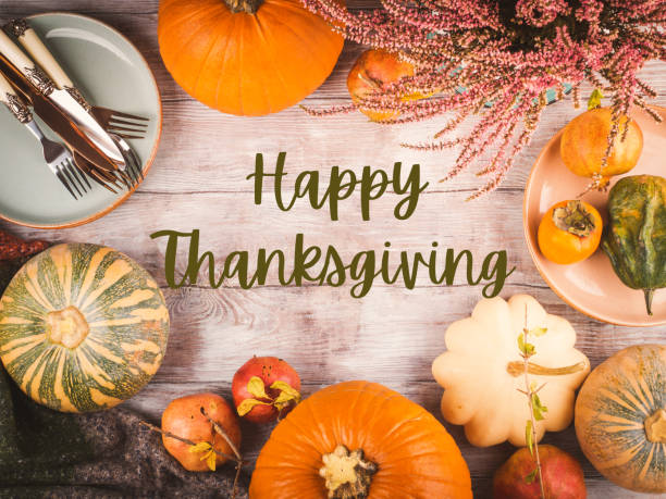 Thanksgiving dinner background with pumpkins stock photo