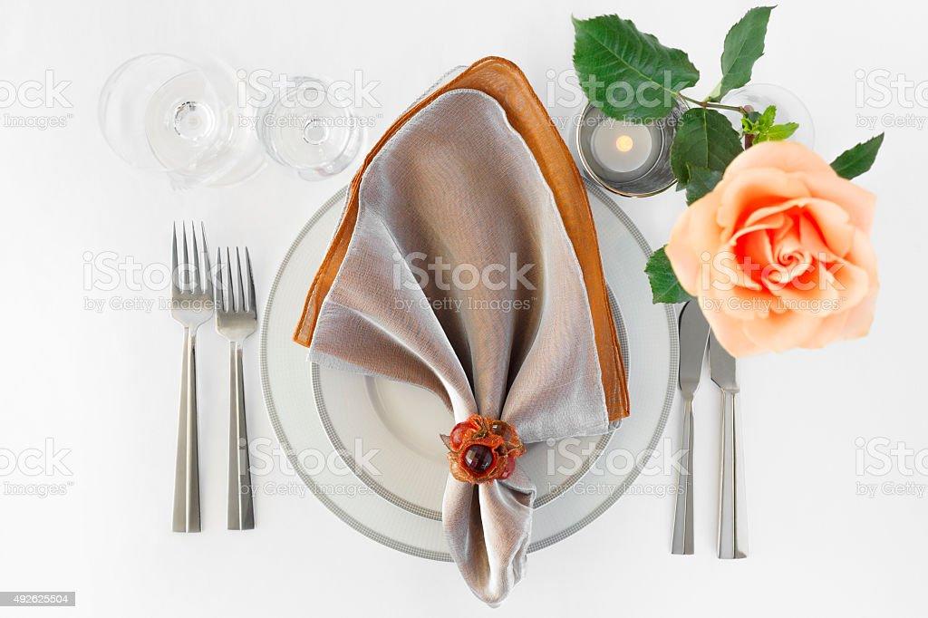 Thanksgiving Dinner Restaurant Set Arrangement Plate Silverware Orange Rose royalty-free stock photo