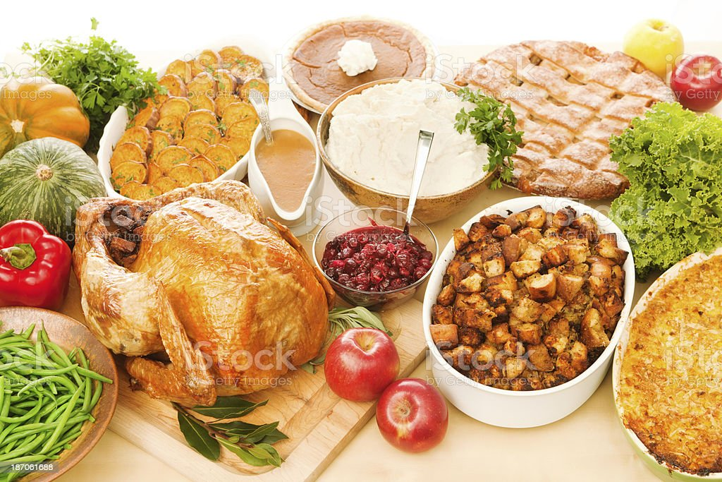 Thanksgiving Dinner Spread with Roasted Turkey & Trimmings Horizontal royalty-free stock photo