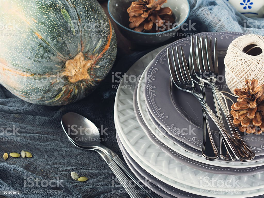 Thanksgiving dinner still life with dishes and cutlery. Toned photo libre de droits