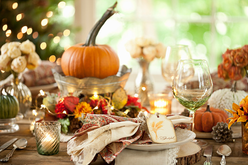 Thanksgiving dining table elegant place setting. Very shallow depth
