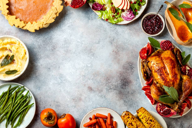 thanksgiving dinner table with roasted whole chicken or turkey, green beans, mashed potatoes, cranberry sauce and grilled autumn vegetables. top view, overhead. - thanksgiving dinner zdjęcia i obrazy z banku zdjęć