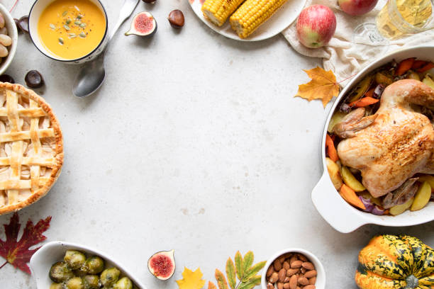 thanksgiving dinner with chicken, apple pie, pumpkin soup brussel sprouts and fruits. - thanksgiving стоковые фото и изображения