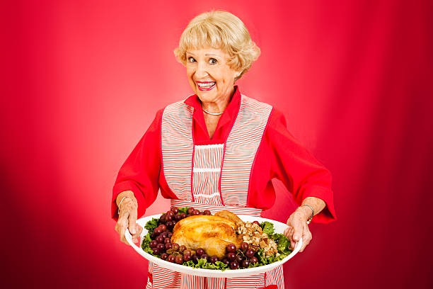thanksgiving dinner with grandma - serving size stock photos and pictures