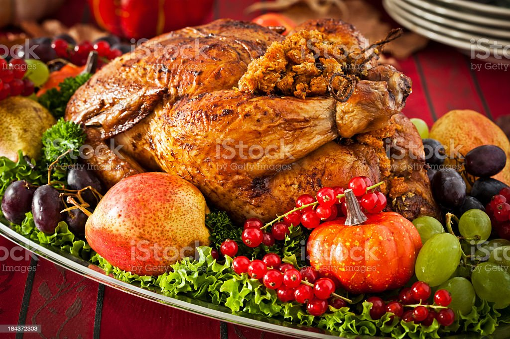 Thanksgiving Dinner with Stuffed Turkey and Side Dishes royalty-free stock photo