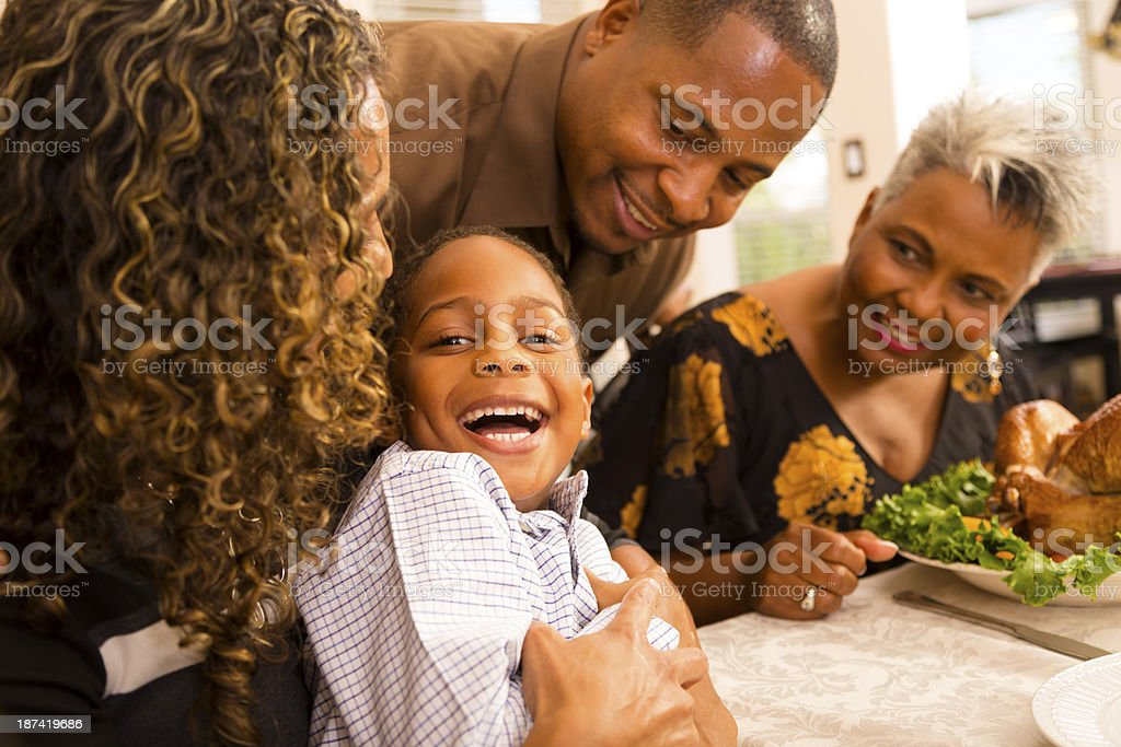 Thanksgiving: Family gathers for dinner at grandma's house. stock photo