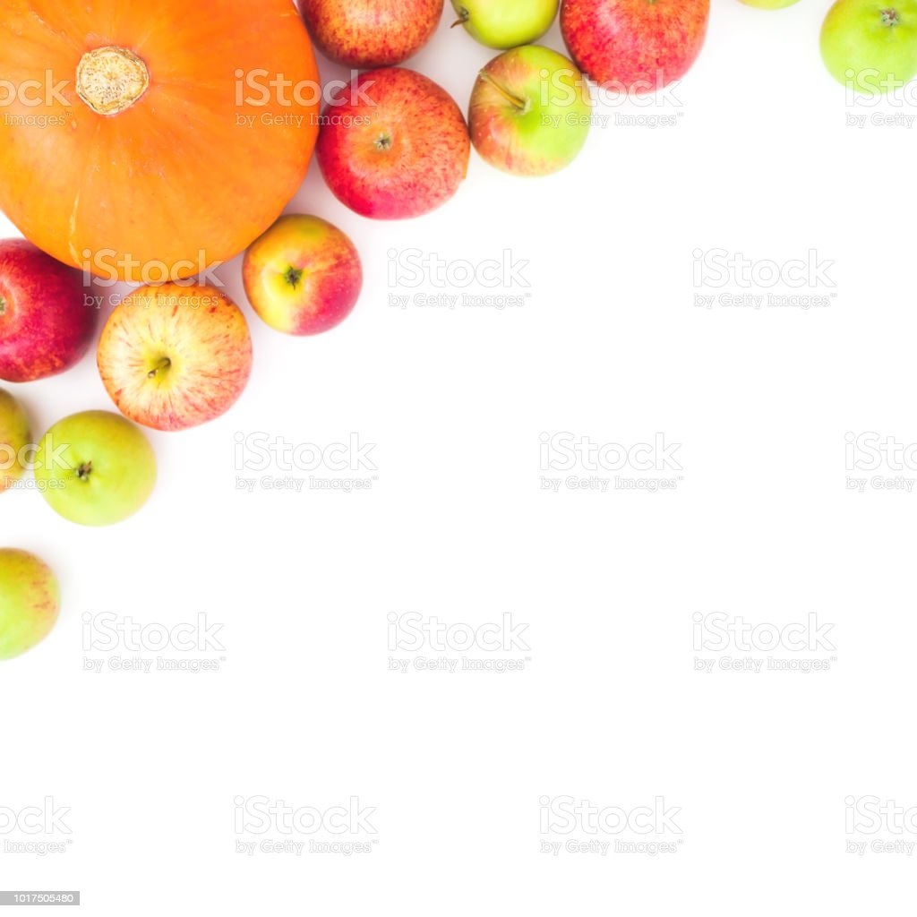 Thanksgiving frame with apples and pumpkin on white background. Flat lay, top view stock photo