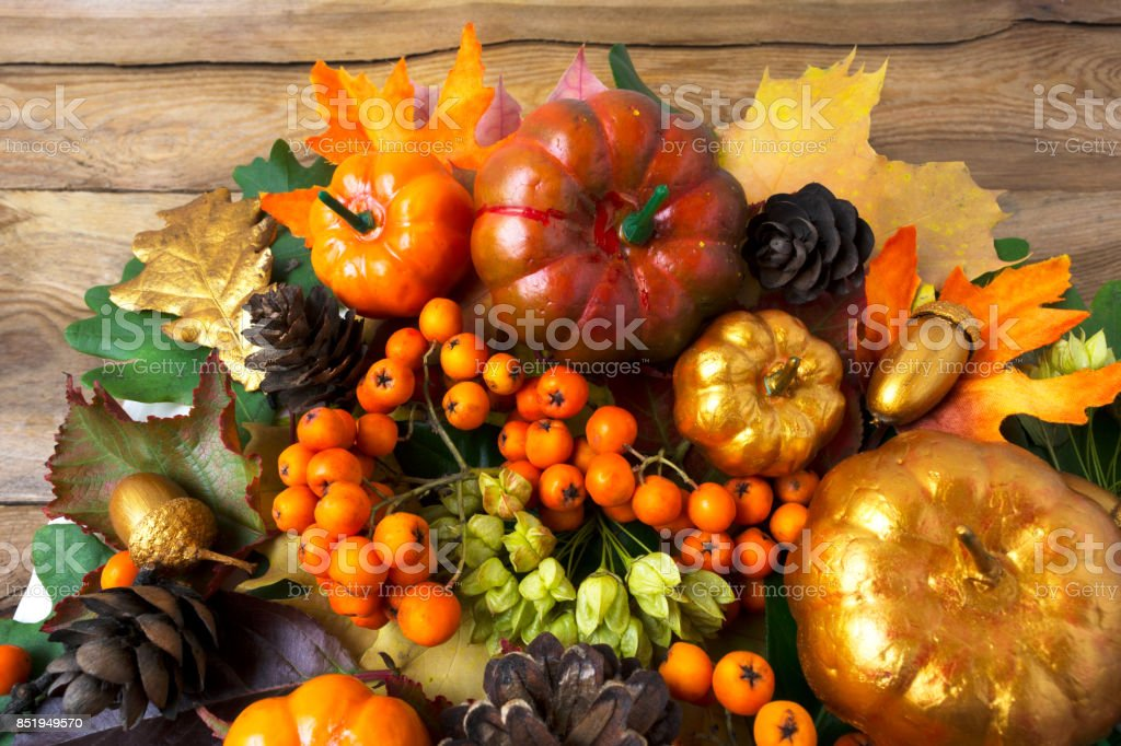 Thanksgiving greenery with golden pumpkins and acorns stock photo