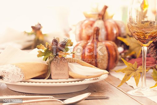 Thanksgiving holiday autumn place setting with place card and greeting