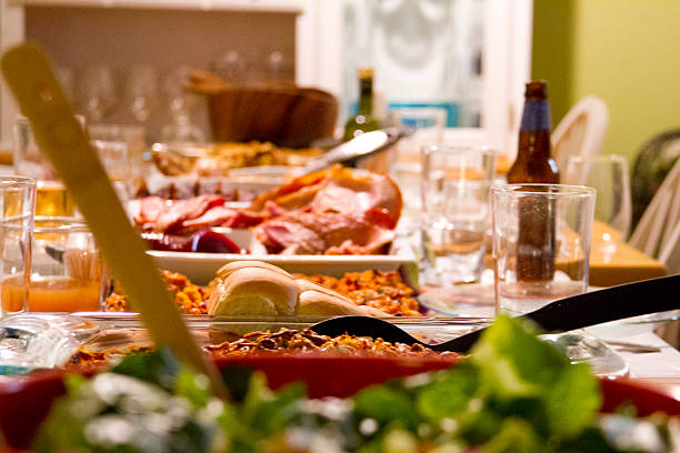 Thanksgiving Meal Table is set for Thanksgiving meal with food. leftovers stock pictures, royalty-free photos & images