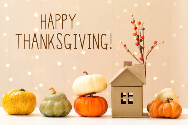 Thanksgiving message with pumpkins with a house stock photo