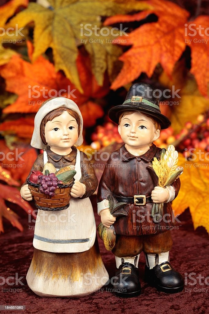 Thanksgiving Pilgrims with Autumn Leaves stock photo