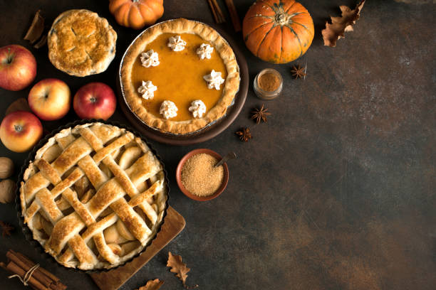 thanksgiving pumpkin and apple various pies - holidays and seasonal stock pictures, royalty-free photos & images