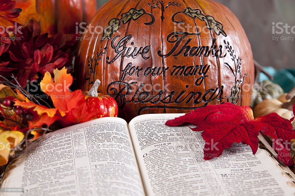 Thanksgiving pumpkin and open Bible to Psalms royalty-free stock photo