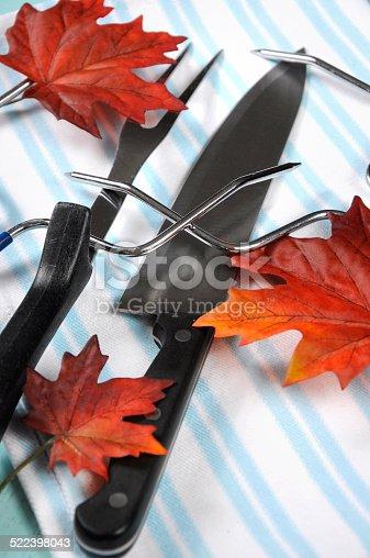 istock Thanksgiving roast turkey carving utensils set 522398043