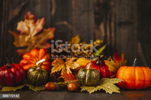 istock Thanksgiving still life background with pumpkins and acorns 599770142