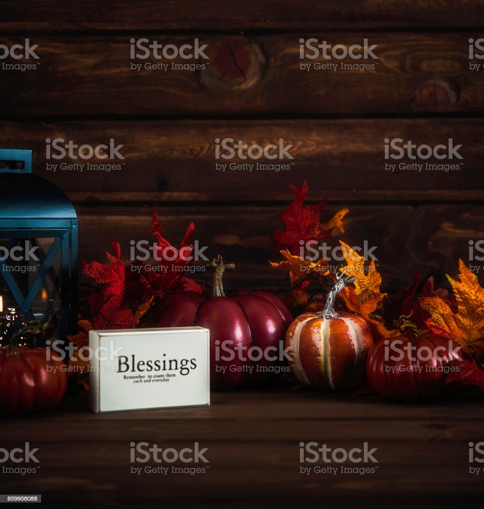 Thanksgiving still life with blessings message and pumpkins stock photo