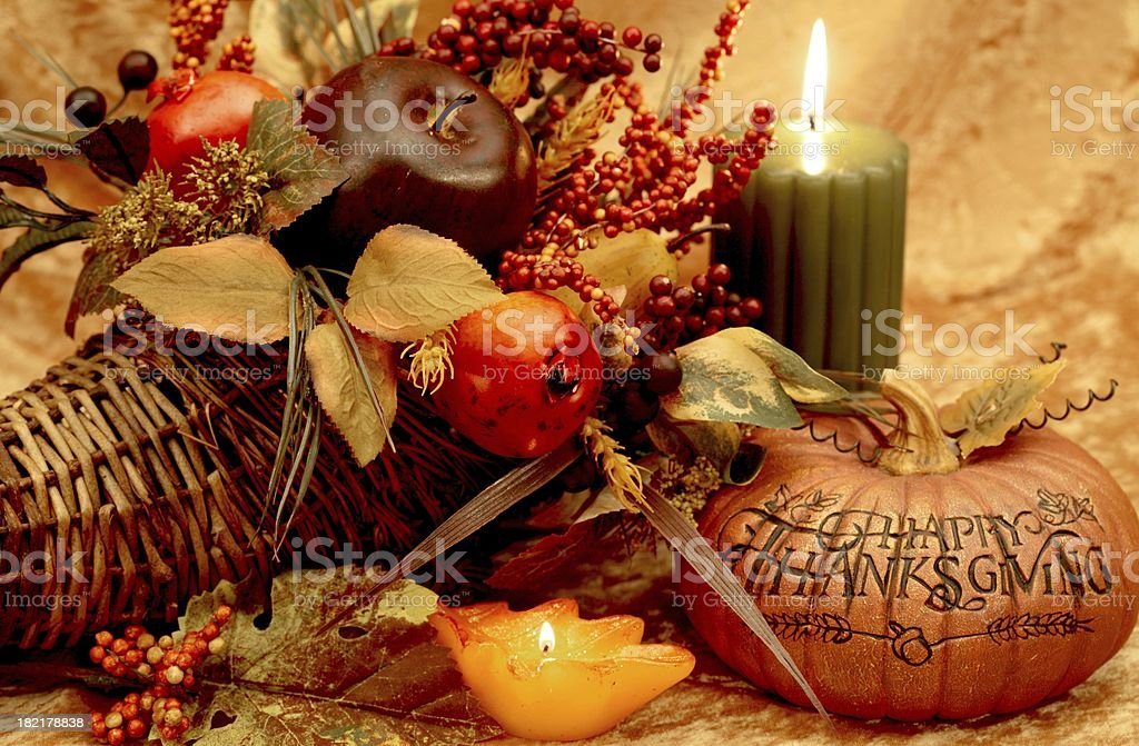 Thanksgiving still life with pumpkin, candle, cornucopia royalty-free stock photo