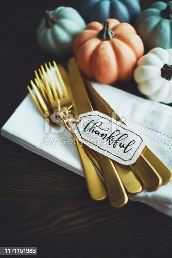 Thanksgiving Table Setting Background with Pumpkins and Gold Cutlery