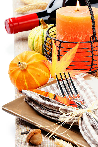 Thanksgiving table setting with pumpkins and candle stock photo