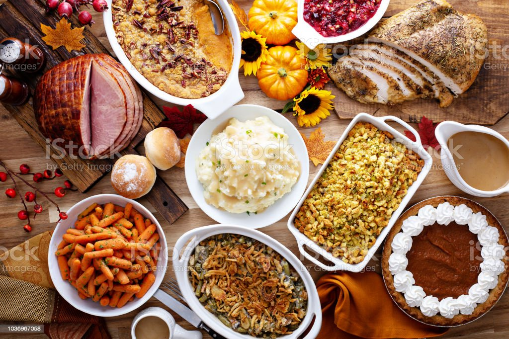Thanksgiving table with turkey and sides stock photo